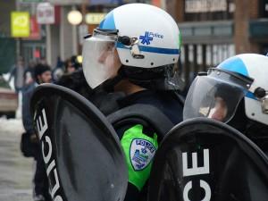 riot cops wearing masks